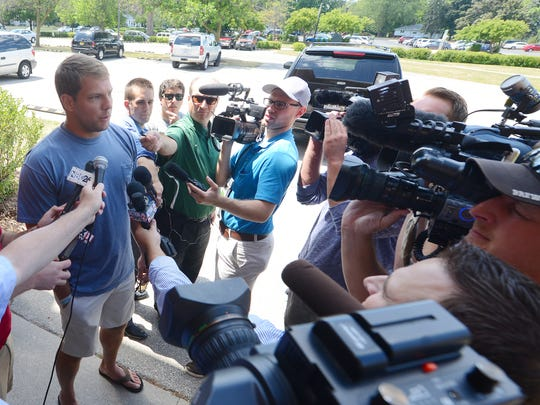 Packers tight end Ryan Taylor, center, faces the media Thursday before checking into Victor McCormick Hall at St. Norbert College