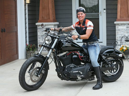 Michelle Swanson, of Musekgo, with her 2014 Harley-Davidson Dyna Street Bob, a cruiser motorcycle.