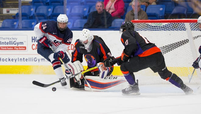 Blade Jenkins (No. 34) of the U.S. NTDP U17s goes after the puck in front of Youngstown goalie Darion Hanson during Saturday's contest.