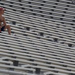A fan has an entire section of the Indianapolis Motor Speedway to himself Sunday as he watches Brickyard 400 NASCAR race.
