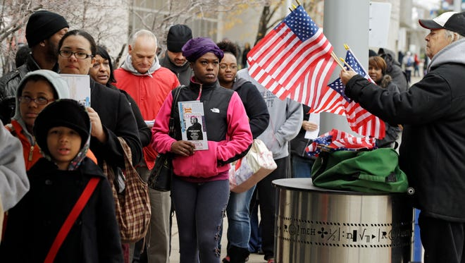 Voters wait in line in Cleveland in 2012.