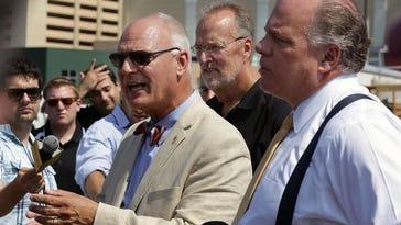 Sen. James Whelan (back center) and Senate President Stephen M. Sweeney (right) listen as Atlantic City Mayor Don Guardian speaks at a 2014 news conference.