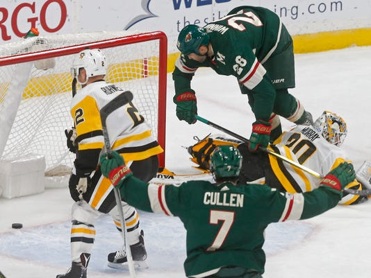 Minnesota Wild's Daniel Winnik, top right, hovers over Pittsburgh Penguins goalie Matt Murray, right, after scoring during the first period of an NHL hockey game Saturday, Oct. 28, 2017, in St. Paul, Minn. (AP Photo/Jim Mone)