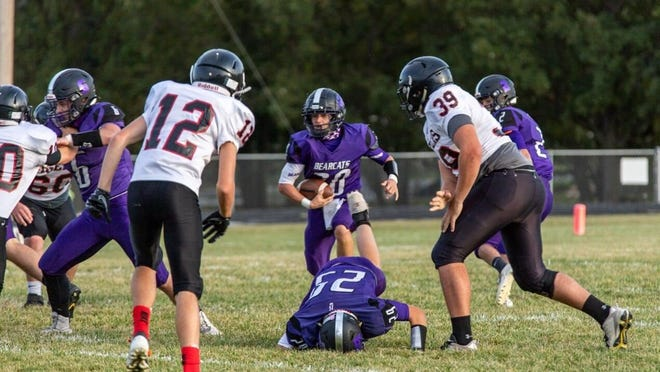Wyatt Ledom (with ball) has helped Burlingame to a 5-2 mark with the lone losses coming to Eight-Man Division I ranked teams Madison and Clifton-Clyde.