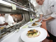 Sous chef Norman Fenton plates during dinner in the kitchen at Bistro 82 in Royal Oak. Bistro 82 restaurant is one of the top ten new restaurants to open in 2014 according to Detroit Free Press restaurant critic Sylvia Rector.
