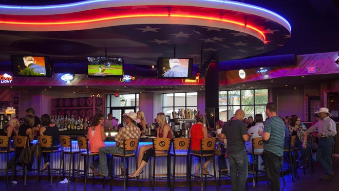 The 85-foot guitar-shaped bar that serves as the centerpiece for the Toby Keith restaurants can't be sold.
