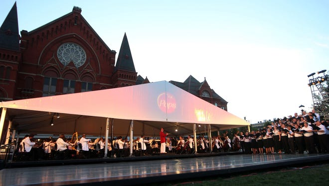 The May Festival Chorus performs with The Cincinnati Pops Orchestra  during the 2013 Lumenocity at Washington Park.