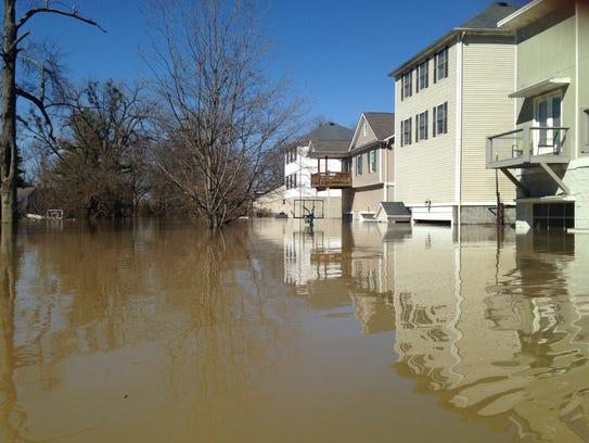 More waterlogged homes in Louisville's Riviera neighborhood.