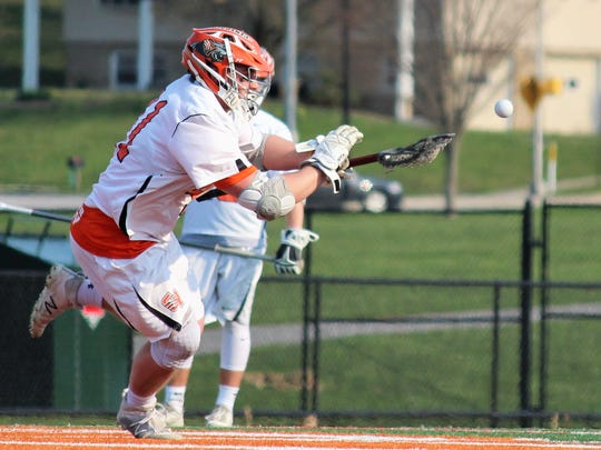 Central York's Kollin Vaught tries to gain possession of the ball after a face-off during a home game against Dallastown. YORK DISPATCH FILE PHOTO