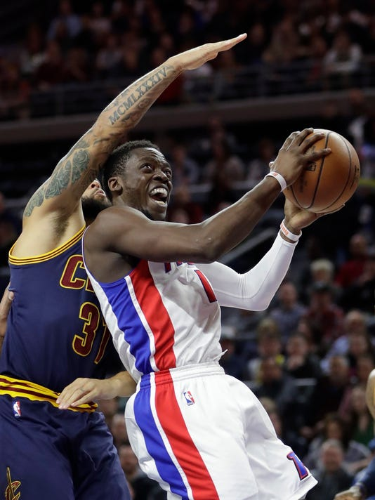 Detroit Pistons guard Reggie Jackson goes to the basket as Cleveland Cavaliers guard Deron Williams defends during the first half of an NBA basketball game, Thursday, March 9, 2017, in Auburn Hills, Mich. (AP Photo/Carlos Osorio)
