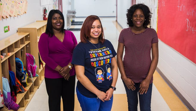 February 23, 2018 - (L-R) Gloria Coleman, human resources generalist, Valencia DeBose, pre-K teacher, and TeEricka Moore, a family service worker, pose for a portrait at Porter-Leath's Vision Preparatory Charter School on Friday. Porter-Leath has a new parental leave policy that offers six weeks of fully paid leave to all new mothers and fathers without requiring them to exhaust their sick and vacation leave first. Debose and Moore will be the first parents to take part in the new parental leave policy.