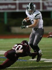 Pleasantville's Charlie McPhee (23) breaks away from