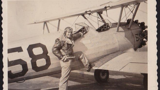 Jim Schaefer with a training plane during World War II.