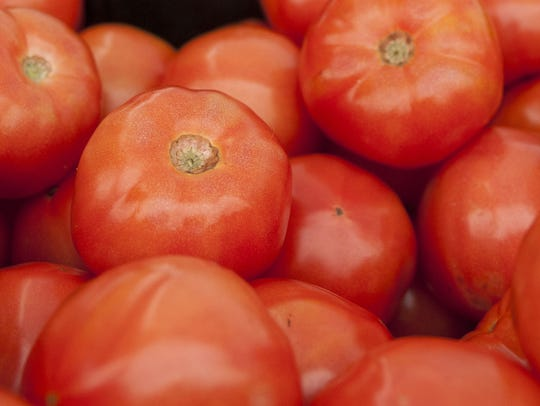 Tomatoes displayed at the Ahwatukee farmers market.