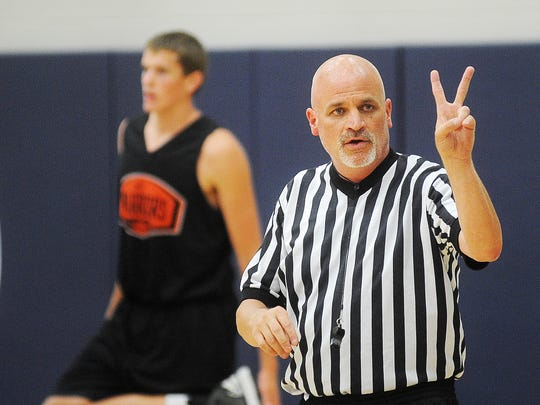 Bret LaCroix, a licensed SDHSAA official, officiates a Summer Jam Basketball League game during the 2014 SDHSAA Officials Jamboree in July. Jamborees off classroom time and on-court practice so officials can get experience.