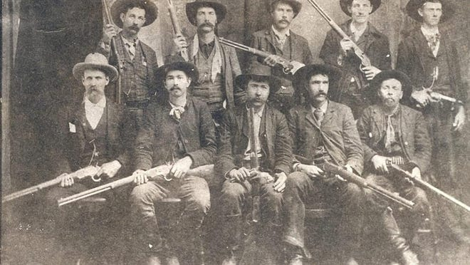 A man identified as Bill Smith, and thought to also be known as William Harvey Smith, is seen with other deputies in an 1892 photo taken after pursuit of Ned Christie. Pictured are Tom Johnson,  back left, Bill Smith, John Tolbit, Abe Allen, Wes Bauman; Captain G.S. White, front left, Charles Copeland, Paden Tolbert, Heck Bruner, and Dave Rusk.