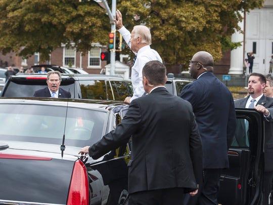 Vice -President Joe Biden waves to the crowd outside