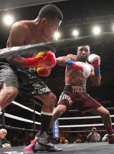 Las Cruces boxer Austin Trout, right, follows Juan De Angel of Barranquilla, Colombia, into a corner of the ring during their bout Saturday night at the Don Haskins Center. Trout won by unanimous decision.