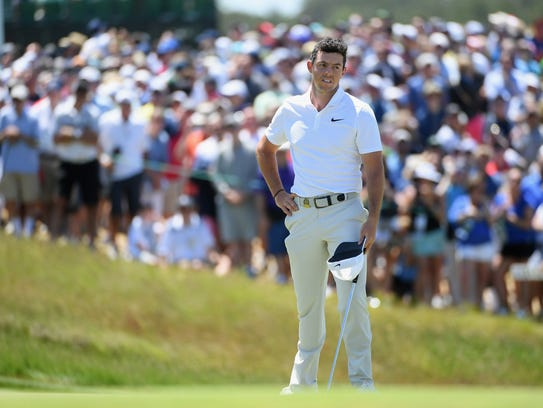 Rory McIlroy reacts on the ninth green during the first