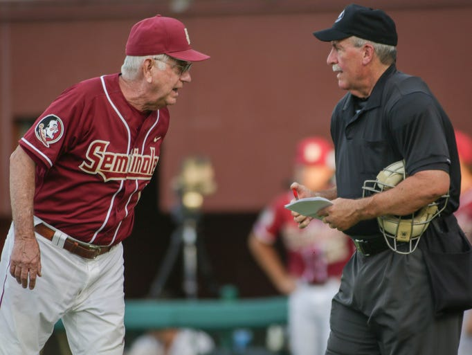 Mike Martin (11) disagrees with the umpire's call during