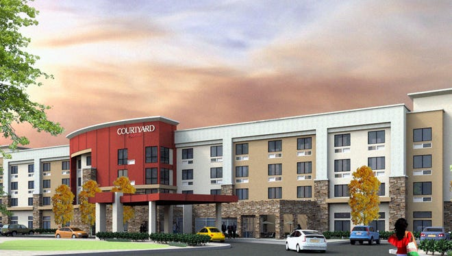 Artists rendering of a planned hotel on the western end of the NMSU campus.