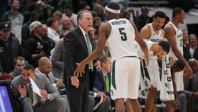 Nov 14, 2017; Chicago, IL, USA; Michigan State Spartans head coach Tom Izzo talks with Michigan State Spartans guard Cassius Winston (5)  during the second half at the United Center.