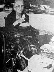 Eula Holden enjoys a piece of birthday cake at her 100th birthday party in 2000.