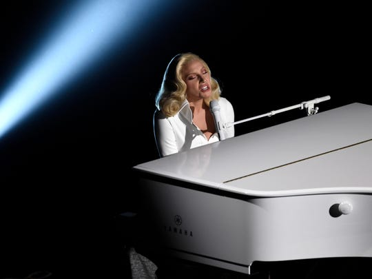 "Lady Gaga performs ""Til It Happens To You,"" nominated for best original song from ""The Hunting Ground"" at the Oscars on Feb. 28, 2016, at the Dolby Theatre in Los Angeles."