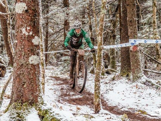 India Waller rides through the snow at Snowshoe Mountain