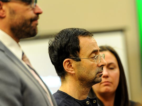 With his lawyers by his side, Larry Nassar listens as his sentence is read by Judge Aquilina Wednesday, Jan. 24, 2018 in Lansing, Michigan.