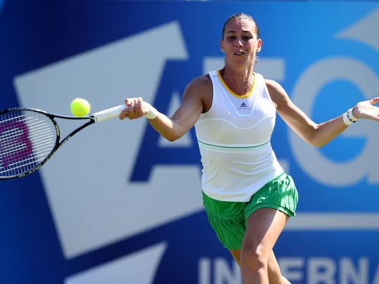 Italy's Flavia Pennetta returns a shot to Heather Watson during the Aegon International tennis tournament at Devonshire Park, Eastbourne, southern England, Wednesday June 18, 2014. (AP Photo/PA, John Walton)  UNITED KINGDOM OUT  NO SALES  NO ARCHIVE