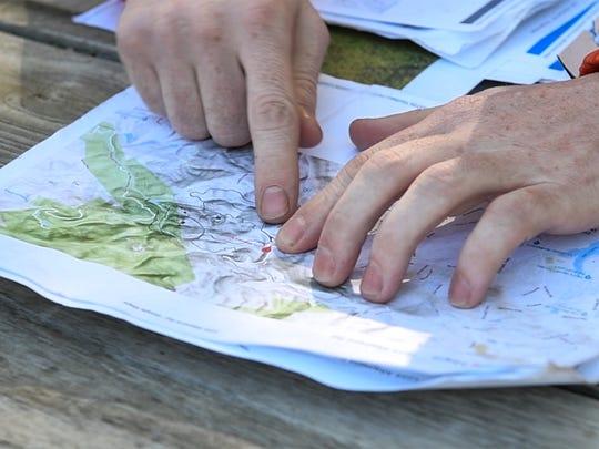 Matthew McDaniel of Seneca points to a map where he