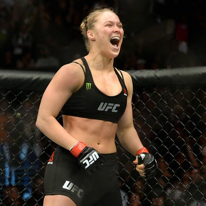 Ronda Rousey (red gloves) reacts after defeating Cat Zingano (not pictured) during their women's bantamweight title bout at UFC 184 at Staples Center.