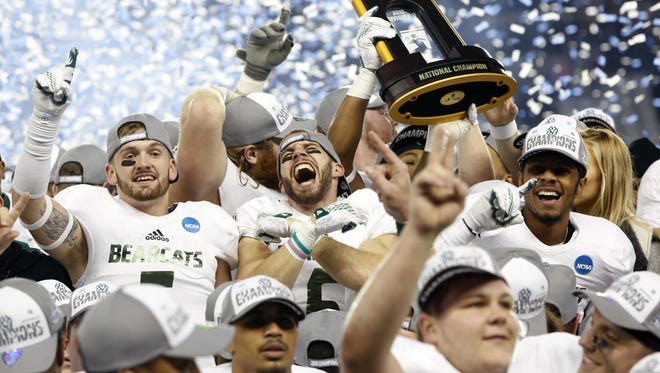 Members of the Northwest Missouri State football team celebrate winning the NCAA Division II national championship against Shepherd on Saturday in Kansas City, Kan. Missouri defeated Shepherd 34-7.