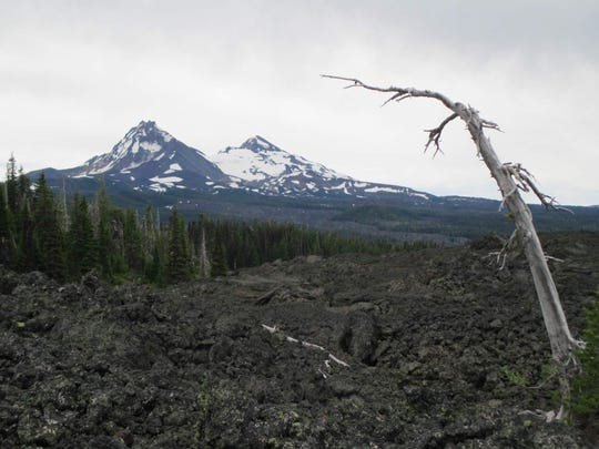 North and Middle Sister as seen from the Pacific Crest Trail near Little Belknap Crater.