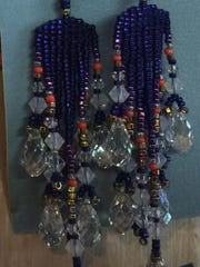 Artist Michelle Passow creates fine bead work jewelry shown in Coach House Gallery.