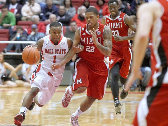 Ball State's Zavier Turner struggles against Miami's defense during their game at Worthen Arena, Jan. 18, 2014.