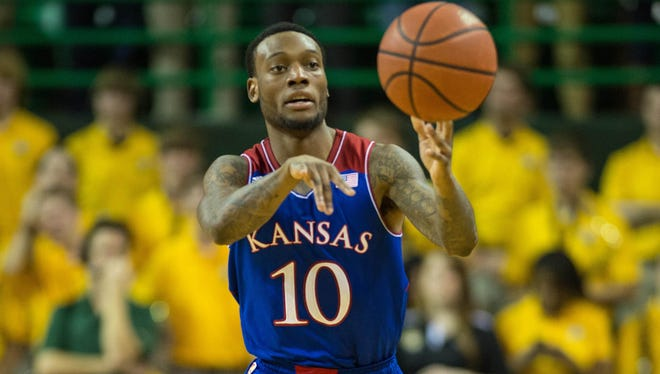 Kansas Jayhawks guard Naadir Tharpe passes the ball during the first half against the Baylor Bears at the Ferrell Center.