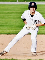 Northville's Nick Broda takes his lead on the base