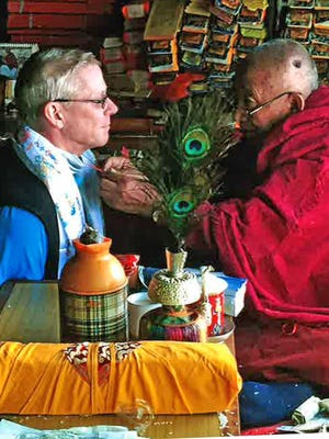 A Buddhist lama blesses Fond du Lac Andy Land before his trip up Mount Everest.