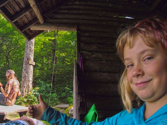Hikers / trail musicians get a thumbs up from Zella Upton, 9, of Burlington at a shelter along the southern end of the Long Trail.