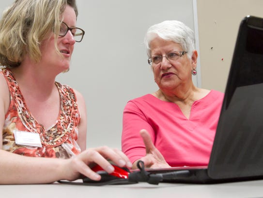 Barbara Lee, right, works with Sarah Neidert of the