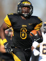 Piscataway football's Zaire Ashley runs in for a touchdown