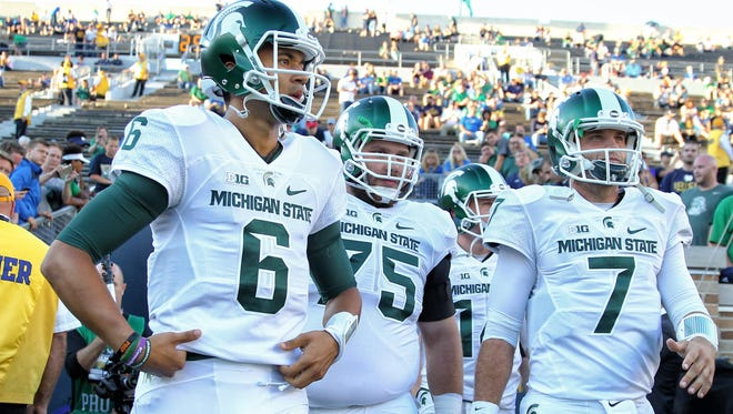 Michigan State quarterbacks Tyler O'Connor (7) and quarterback Damion Terry (6) take the field prior to MSU's game against the Notre Dame on Sept. 17. Those were different times for MSU's football team, less than a month ago. Since that victory, the Spartans have dropped three straight and, late in Saturday's loss to BYU, Terry, replaced O'Connor.