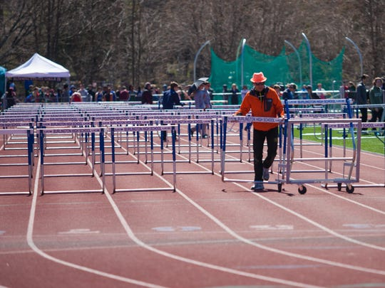 Pavel Dvorak sets up hurdles at the 44th annual Burlington Invitational track and field meet last month at Burlington High School.