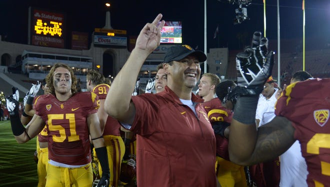 Head coach Steve Sarkisian flashes a smile after a dominant win in his USC debut.