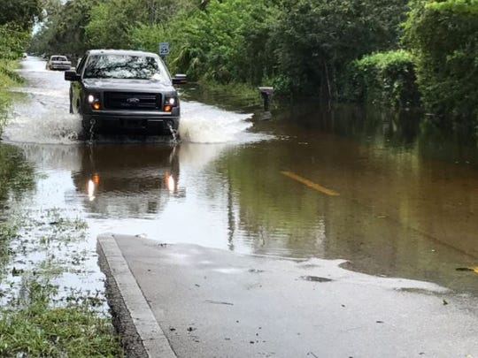 Some vehicles are braving the Hurricane Irma floodwaters in Lakewood Park.