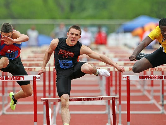 Central York's Jay Stone races toward a win in the Class AAA 110 hurdles Saturday at the District 3 Track and Field Championships. (For the Daily Record/Sunday News -- Chris Knight)