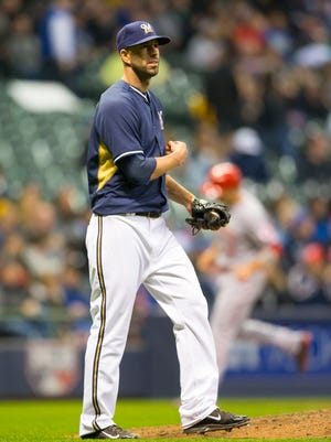 Milwaukee Brewers pitcher Mike Fiers gives up a grand slam during the fourth inning Tuesday against the Cincinnati Reds at Miller Park.