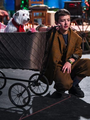 Queenie (Dot the dog), left, stands in a baby stroller near Little Buddy (Will McDonald) during a play rehearsal for A Christmas Memory at the Electric City Playhouse in Anderson. The play is based on a short story by Truman Capote, and directed by Jimmy O. Burdette. Set in Alabama in 1933, A Christmas Memory tells the story of young Buddy, who is being raised by three eccentric cousins, and their last, precious Christmas together at home.